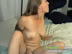 very Hot tattoed blonde wanking her pussy on webcam