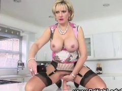 Stockinged mature british Lady Sonia rides her dildo