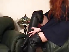 Redhead In Living Room Showing Off Boots