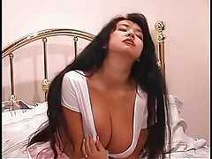 An exotic slut with large beautiful tits twists her awesome nipples